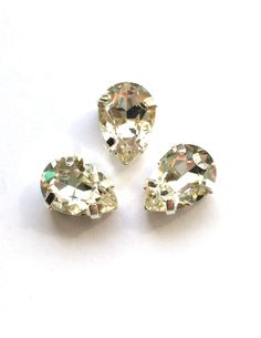 Капля в серебристых цапах качество люкс, 7х10 мм., цвет 101, кристалл